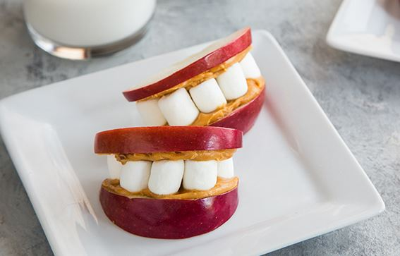 novelty food image of denture made from apple slices, marshmallows and nut butter from Campfire Marshmallows