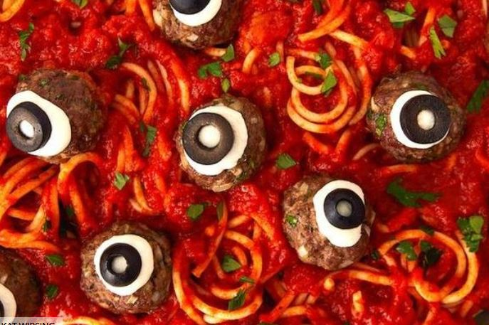 novelty food image of pasta and meatballs that look like eyeballs from Delish