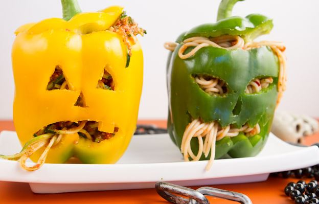 novelty food peppers cut like jack o'lanterns with spaghetti inside from Healthful Pursuit