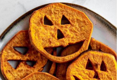 novelty food image of sweet potato sliced like lanterns for halloween from simplyjillicious.com