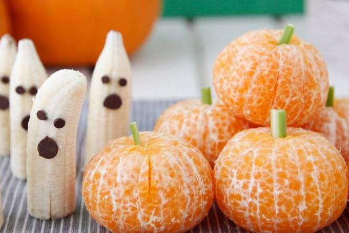 novelty food image of banana choc chip ghosts and peeled tangerines made to look like pumpkins from Weelicious